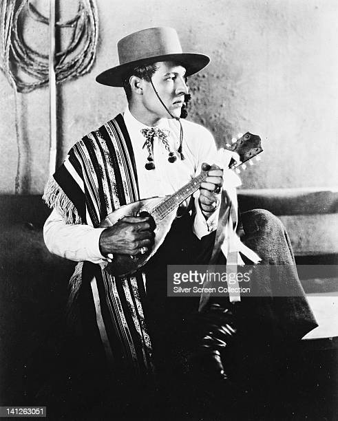 Rudolph Valentino Italian silent movie actor wearing a gaucho hat with a striped poncho in a publicity portrait issued for the film 'The Four...