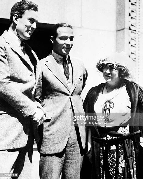 Rudolph Valentino, the screen's greatest lover, arrested for bigamy, stands outside the court house in Los Angeles, California. He is charged with...