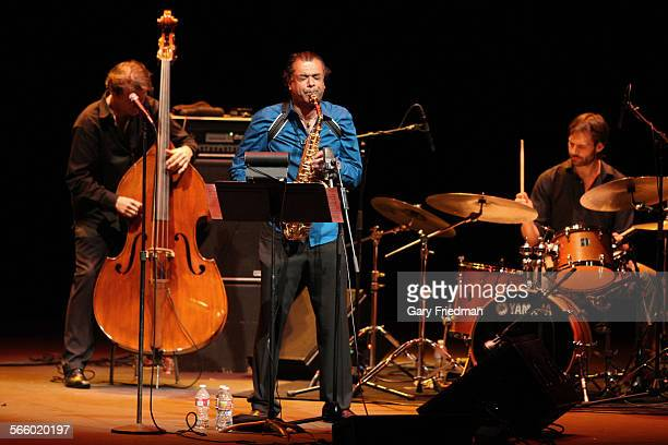 Rudresh Mahanthappa on alto saxophone as he plays with Gamak at UCLA's Royce Hall in the Westwood area of Los Angeles on March 2 2013 At right is Dan...