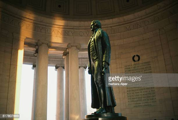 Rudulph Evans's statue of Thomas Jefferson with excerpts of the Declaration of Independence seen behind Thomas Jefferson Memorial Washington DC USA...