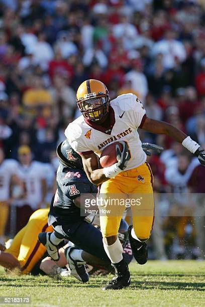 Rudy Burgess of the Arizona State Sun Devils runs the ball during the game against the Arizona Wildcats at Arizona Stadium on November 26 2004 in...