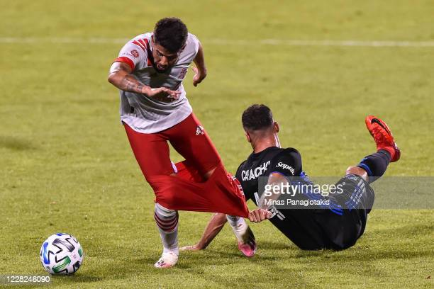 Rudy Camacho of the Montreal Impact pulls down the shorts of Alejandro Pozuelo of Toronto FC as he falls during the second half of the MLS game at...