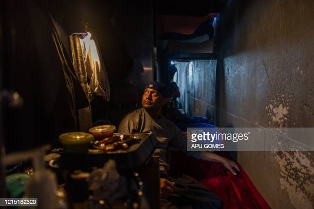 Rudy Campos 43 yearsold sits inside his tent under the bridge of the 110 Freeway at 39th Street during the novel Coronavirus COVID19 pandemic in Los...