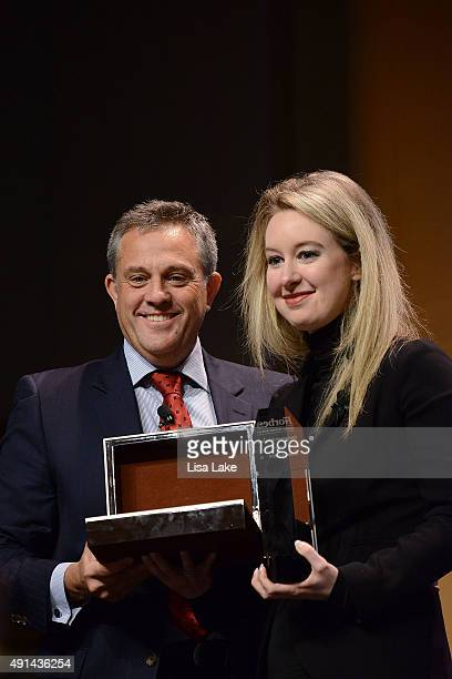 Rudy Chavez President of Baume Mercier North America presents Elizabeth Holmes Founder CEO of Theranos with Forbes Under 30 Doers Award at Forbes...