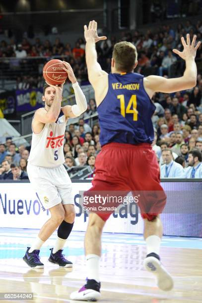 Rudy Fernandez #5 guard of Real Madrid and Aleksandar Vezenkov #14 forward of FC Barcelona during the Liga Endesa game between Real Madrid v FC...