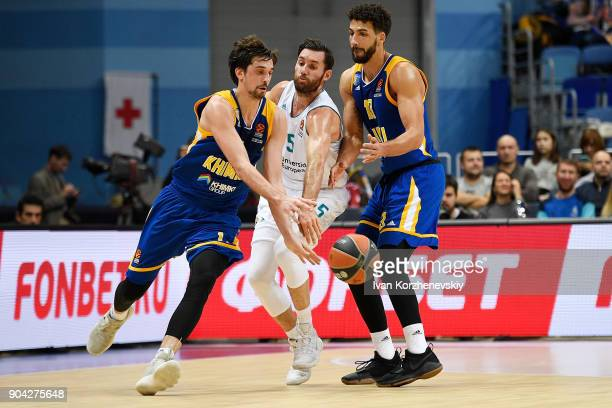 Rudy Fernandez #5 of Real Madrid competes with Alexey Shved #1 of Khimki Moscow Region and Anthony Gill #13 of Khimki Moscow Region during the...