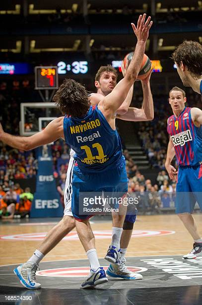 Rudy Fernandez of Real Madrid competes with Juan Carlos Navarro of FC Barcelona Regal during the Semifinal B game between FC Barcelona Regal v Real...