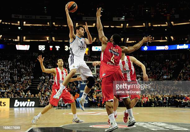 Rudy Fernandez of Real Madrid tussles with Kyle Hines of Olympiacos Piraeus during the Turkish Airlines EuroLeague Final Four final between...