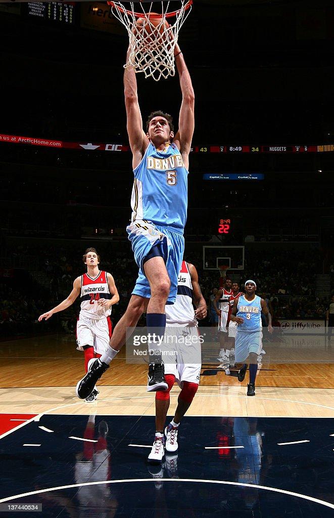 Rudy Fernandez #5 of the Denver Nuggets dunks against the Washington Wizards during the game at the Verizon Center on January 20, 2012 in Washington, DC.