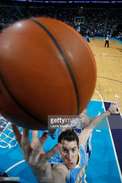 Rudy Fernandez of the Denver Nuggets reaches the ball during an NBA game between the Denver Nuggets and the New Orleans Hornets on January 6 2012 at...