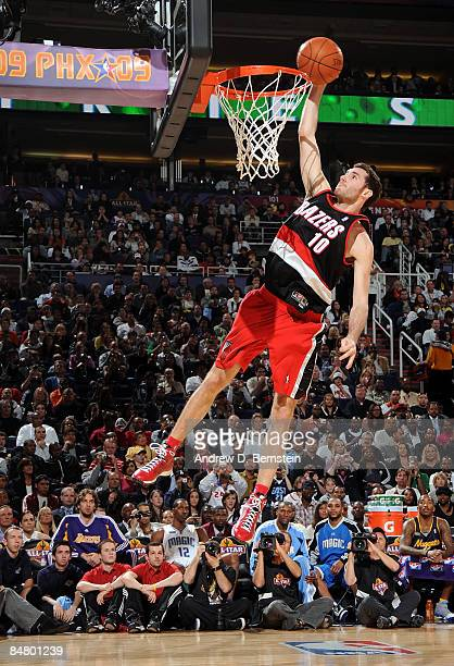 Rudy Fernandez of the Portland Trail Blazers attempts a dunk as he participates in the Sprite Slam Dunk Contest on AllStar Saturday Night part of...