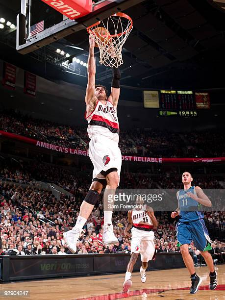 Rudy Fernandez of the Portland Trail Blazers dunks the ball past Aleksandar Pavlovic of the Minnesota Timberwolves during a game on November 8 2009...