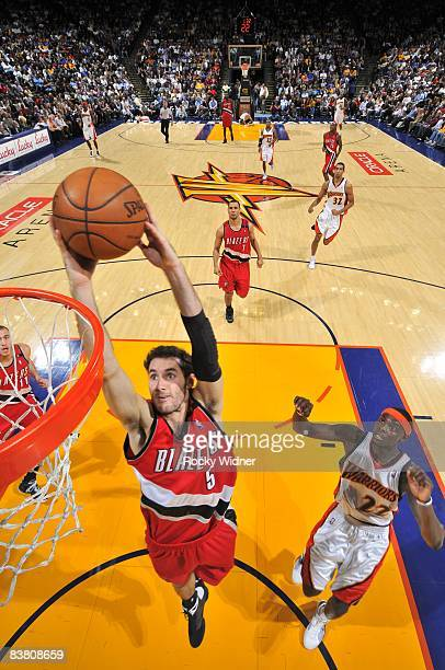Rudy Fernandez of the Portland Trail Blazers takes the ball to the basket against Anthony Morrow of the Golden State Warriors during the game at The...