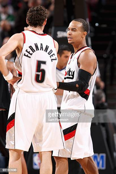 Rudy Fernandez talks to Jerryd Bayless of the Portland Trail Blazers during the game against the San Antonio Spurs on November 6 2009 at the Rose...