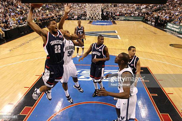 Rudy Gay of the Connecticut Huskies dunks against Will Sheridan of the Villanova Wildcats on February 13 2006 at the Wachovia Center in Philadelphia...