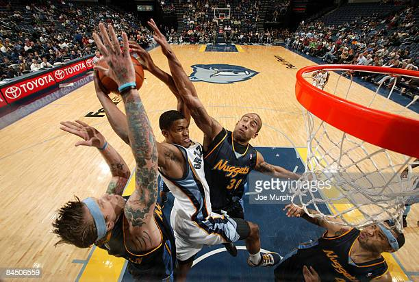 Rudy Gay of the Memphis Grizzlies drives to the basket between Chris Andersen and Dahntay Jones of the Memphis Grizzlies at FedExForum January 27,...