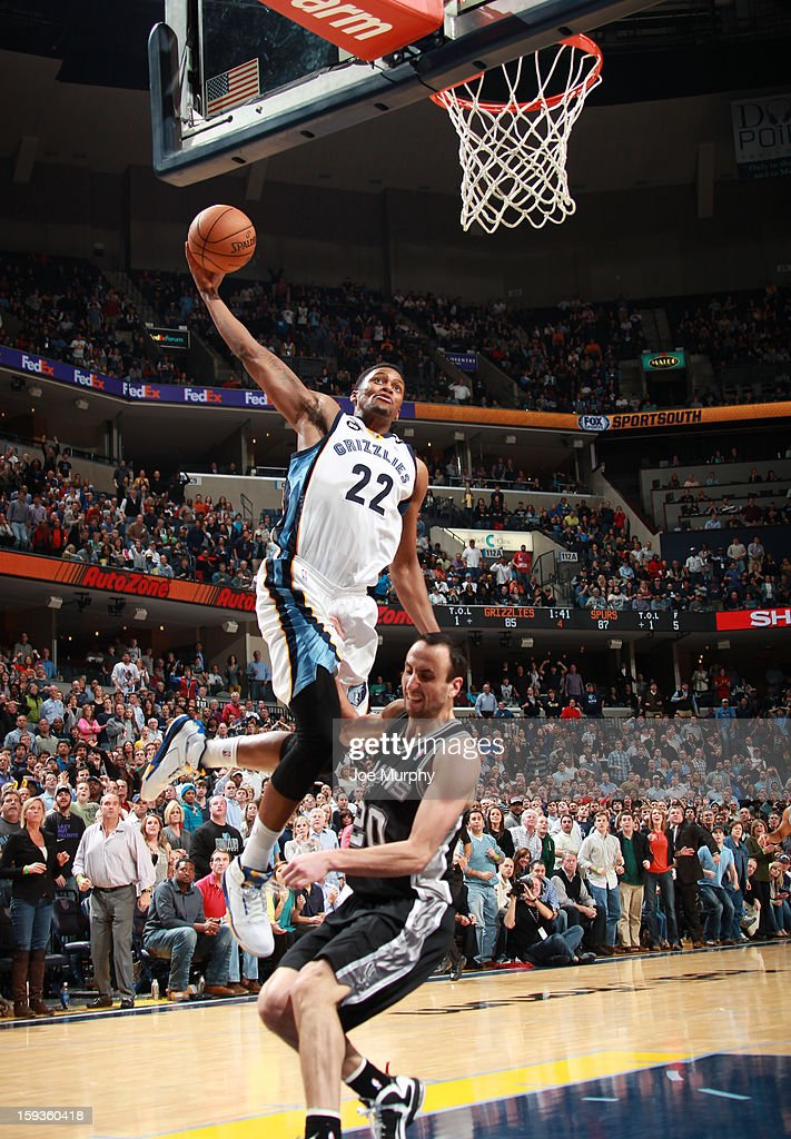 Rudy Gay #22 of the Memphis Grizzlies dunks against Manu Ginobili #20 of the San Antonio Spurs on January 11, 2013 at FedExForum in Memphis, Tennessee.