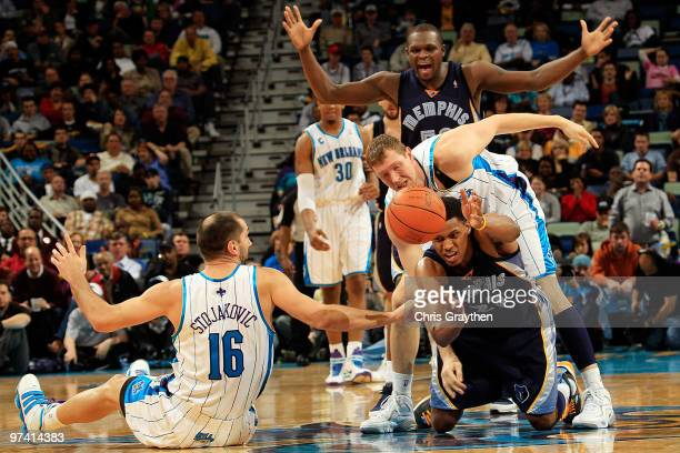 Rudy Gay of the Memphis Grizzlies passes away a loose ball from Peja Stojakovic and Darius Songaila of the New Orleans Hornets at the New Orleans...