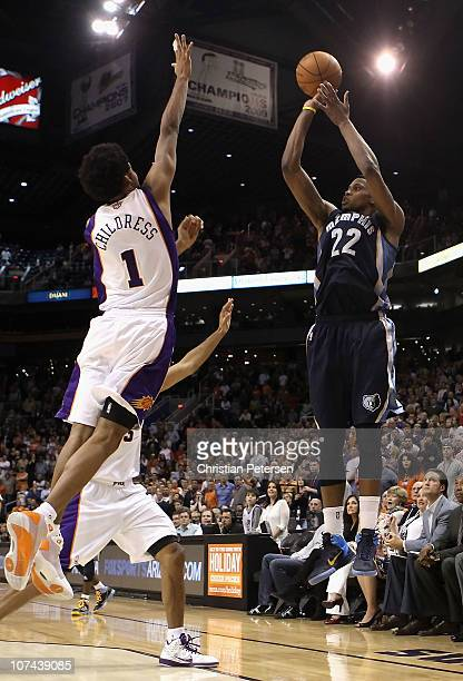 Rudy Gay of the Memphis Grizzlies puts up the game tying three point shot over Josh Childress of the Phoenix Suns at the end of regulation in the NBA...