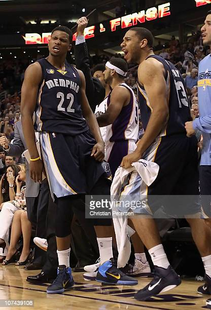 Rudy Gay of the Memphis Grizzlies reacts with Xavier Henry after Gay hit the game tying three point shot against the Phoenix Suns at the end of...