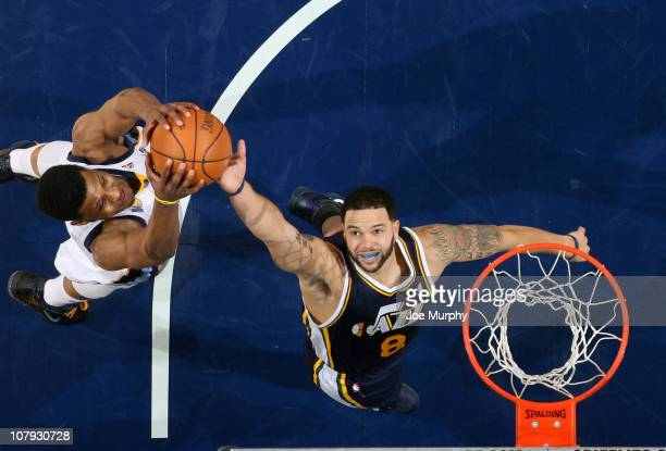 Rudy Gay of the Memphis Grizzlies rebounds against Deron Williams the Utah Jazz on January 7 2011 at FedExForum in Memphis Tennessee NOTE TO USER...