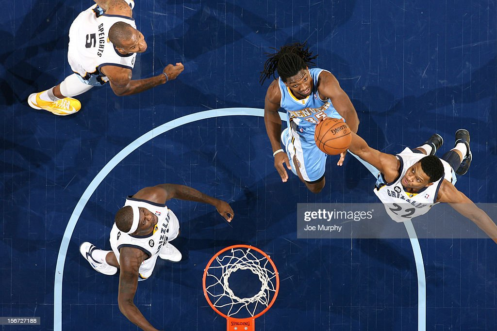 Rudy Gay #22 of the Memphis Grizzlies rebounds against Kenneth Faried #35 of the Denver Nuggets on November 19, 2012 at FedExForum in Memphis, Tennessee.