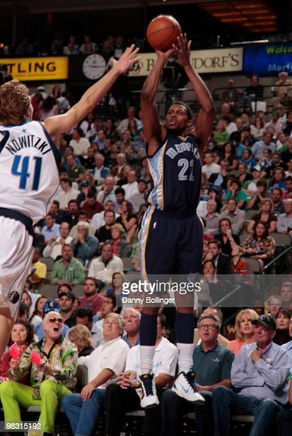 Rudy Gay of the Memphis Grizzlies shoots a jumper against Dirk Nowitzki of the Dallas Mavericks during a game at the American Airlines Center on...