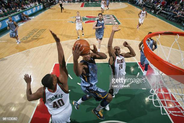 Rudy Gay of the Memphis Grizzlies shoots a layup against Kurt Thomas and Jerry Stackhouse of the Milwaukee Bucks on March 28 2010 at the Bradley...