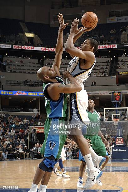 Rudy Gay of the Memphis Grizzlies shoots over Jerry Stackhouse of the Dallas Mavericks on January 31 2007 at FedExForum in Memphis Tennessee NOTE TO...