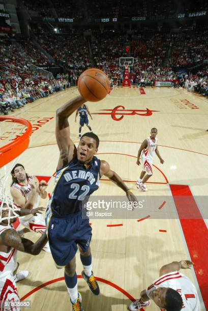 Rudy Gay of the Memphis Grizzlies shoots the ball over Trevor Ariza of the Houston Rockets on March 17 2010 at the Toyota Center in Houston Texas...