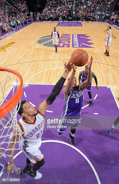 Rudy Gay of the Sacramento Kings rebounds against Andre Roberson of the Oklahoma City Thunder on November 23, 2016 at Golden 1 Center in Sacramento,...