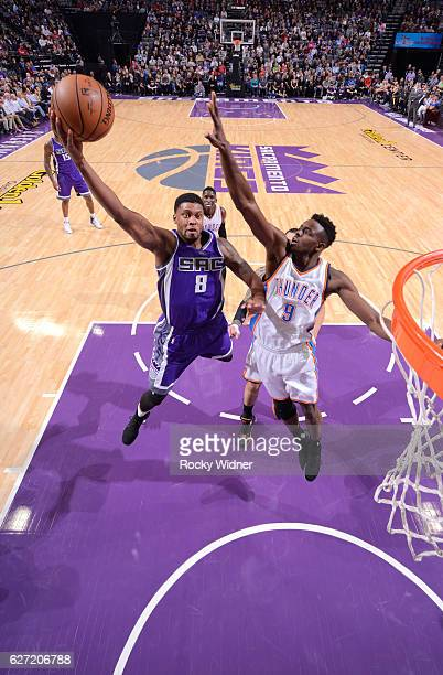 Rudy Gay of the Sacramento Kings shoots a layup against Jerami Grant of the Oklahoma City Thunder on November 23, 2016 at Golden 1 Center in...