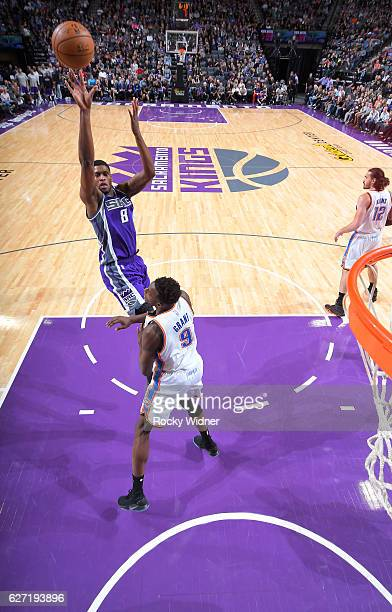 Rudy Gay of the Sacramento Kings shoots against Jerami Grant of the Oklahoma City Thunder on November 23 2016 at Golden 1 Center in Sacramento...