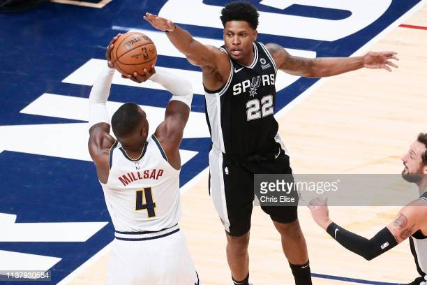 Rudy Gay of the San Antonio Spurs blocks a shot against Paul Millsap of the Denver Nuggets during Game Two of Round One of the 2019 NBA Playoffs on...