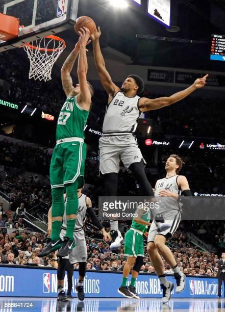 Rudy Gay of the San Antonio Spurs blocks the shot of Daniel Theis of the Boston Celtics at ATT Center on December 08 2017 in San Antonio Texas NOTE...