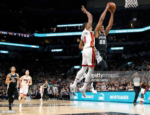 Rudy Gay of the San Antonio Spurs drives in front of Josh Richardson of the Miami Heat at ATT Center on December 06 2017 in San Antonio Texas NOTE TO...