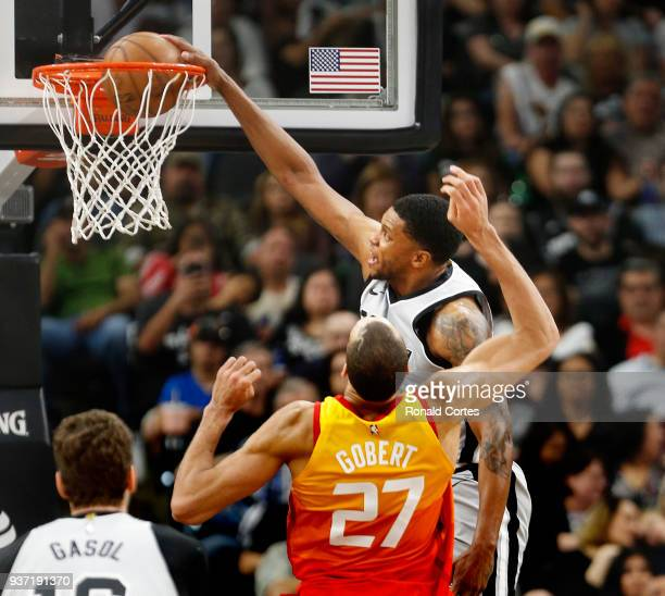 Rudy Gay of the San Antonio Spurs dunks in front of Rudy Gobert of the Utah jazz at ATT Center on March 23 2018 in San Antonio Texas NOTE TO USER...