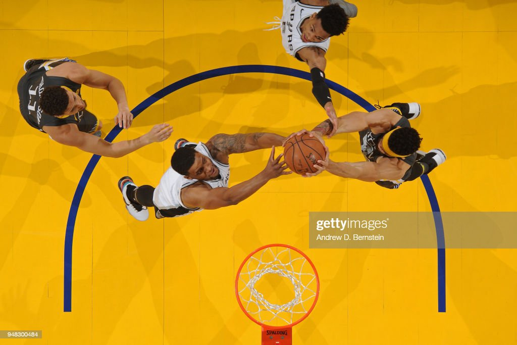 Rudy Gay #22 of the San Antonio Spurs fights for the ball against JaVale McGee #1 of the Golden State Warriors during Game Two of Round One of the 2018 NBA Playoffs on April 16, 2018 at ORACLE Arena in Oakland, California.