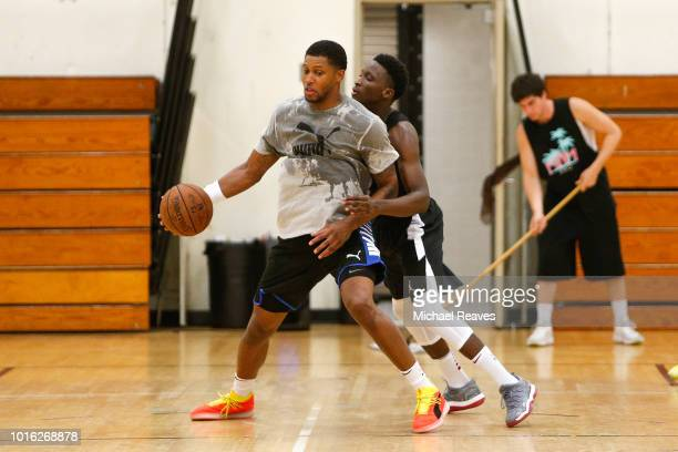 Rudy Gay of the San Antonio Spurs is defended by Victor Oladipo of the Indiana Pacers during NBA Offseason training with Remy Workouts on August 9...