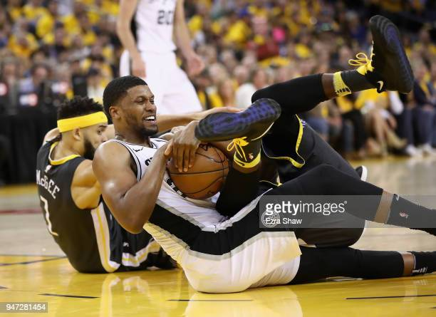 Rudy Gay of the San Antonio Spurs scrambles for a loose ball against JaVale McGee and Draymond Green of the Golden State Warriors during Game 2 of...