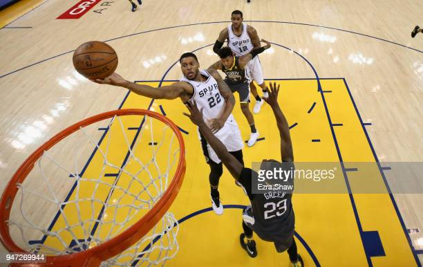 Rudy Gay of the San Antonio Spurs shoots over Draymond Green of the Golden State Warriors during Game 2 of Round 1 of the 2018 NBA Playoffs at ORACLE...