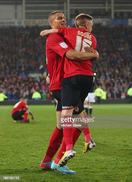 Rudy Gestede and Craig Noone of Cardiff City celebrate their team's promotion to the Premier League at the end of the npower Championship match...