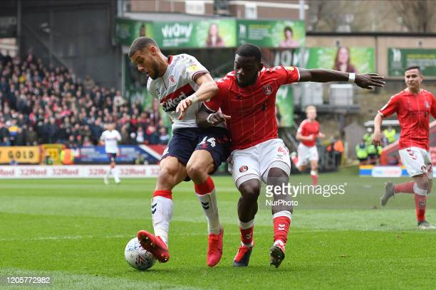 Rudy Gestede and Deji Oshilaja in action during the Sky Bet Championship match between Charlton Athletic and Middlesbrough at The Valley London on...