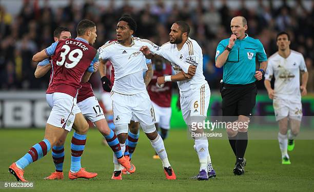 Rudy Gestede of Aston Villa and Ashley Williams of Swansea City face off while players try to separate them during the Barclays Premier League match...
