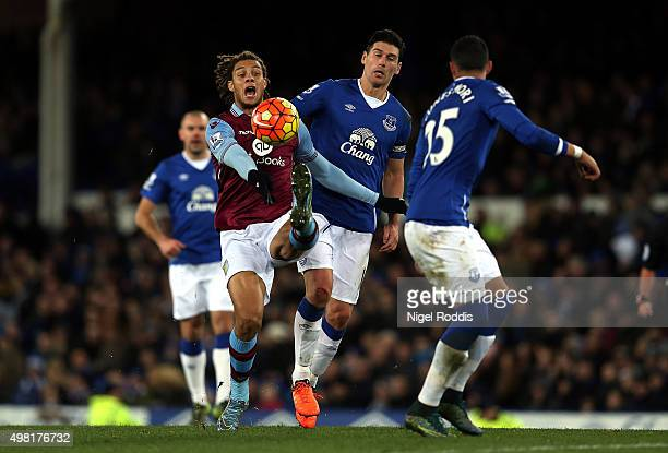 Rudy Gestede of Aston Villa and Gareth Barry of Everton compete for the ball during the Barclays Premier League match between Everton and Aston Villa...