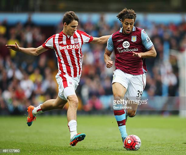 Rudy Gestede of Aston Villa and Philipp Wollscheid of Stoke City compete for the ball during the Barclays Premier League match between Aston Villa...