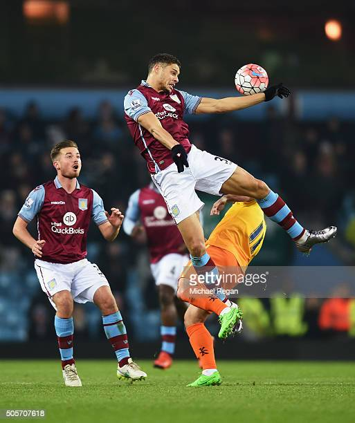 Rudy Gestede of Aston Villa and Sam Wood of Wycombe Wanderers compete for the ball during the Emirates FA Cup Third Round Replay match between Aston...