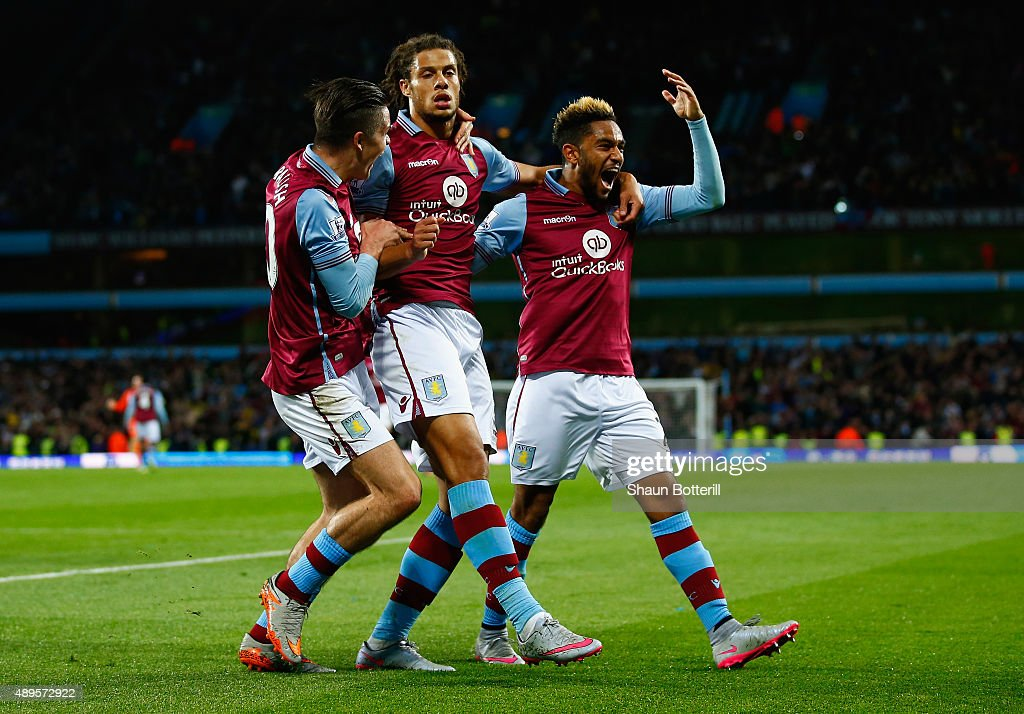 Rudy Gestede of Aston Villa (C) celebrates scoring their first goal with Jack Grealish and Jordan Amavi of Aston Villa during the Capital One Cup third round match between Aston Villa and Birmingham City at Villa Park on September 22, 2015 in Birmingham, England.