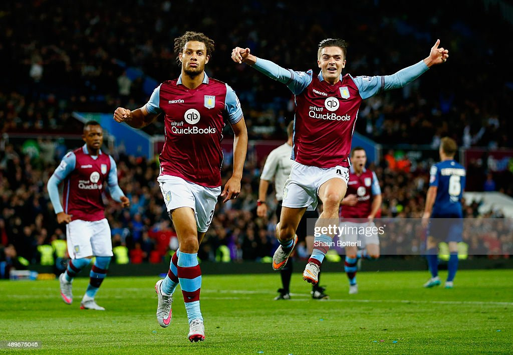 Rudy Gestede of Aston Villa (L) celebrates scoring their first with Jack Grealish of Aston Villa during the Capital One Cup third round match between Aston Villa and Birmingham City at Villa Park on September 22, 2015 in Birmingham, England.
