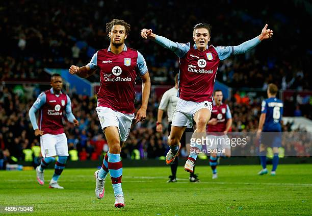 Rudy Gestede of Aston Villa celebrates scoring their first with Jack Grealish of Aston Villa during the Capital One Cup third round match between...